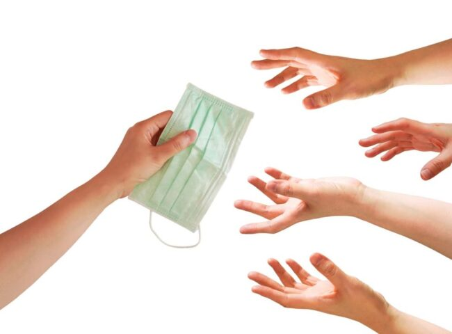 A hand give a face mask with many hands try to grab or capture ,